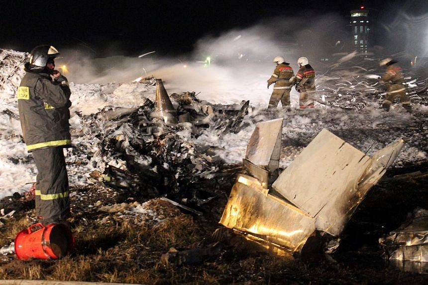 A handout photo provided early on Monday, Nov 18, 2013, by the Russian Emergencies Ministry's press service shows rescuers working at the crash site of a Boeing 737 passenger airliner in the international airport of Russia's Volga city of Kazan.&nbsp