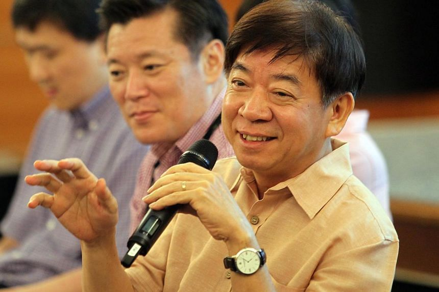 """National Development Minister Khaw Boon Wan speaking to participants of an Our Singapore Conversation (OSC) dialogue on housing last week. On Nov 18, 2013, Mr Khaw said details of Singapore's next Master Plan will be unveiled """"very soon"""". -- ST FILE"""