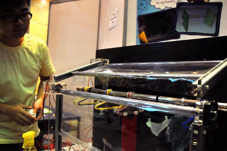 A Nanyang Technological University (NTU) student displays his innovation at the pre-event showcase of the Engineering Innovation & Design Open House in 2011. NTU has managed to attract 50 top A-level students to engineering through its elite Rena