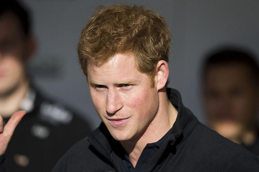 Britain's Prince Harry makes a speech on stage as he attends the Walking With The Wounded South Pole Allied Challenge departure event in Trafalgar Square, London, on Thursday, Nov 14, 2013. -- PHOTO: AP
