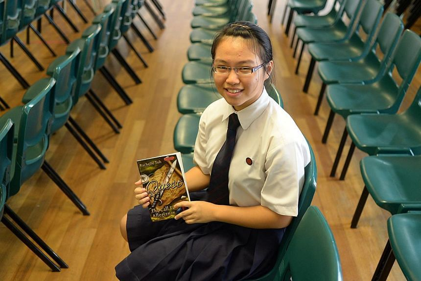 While her peers were fretting over the Primary School Leaving Examination, Rachelle Toh spent her free time holed up in her bedroom imagining an enchanted realm. And writing about it. -- ST PHOTO: JAMIE KOH