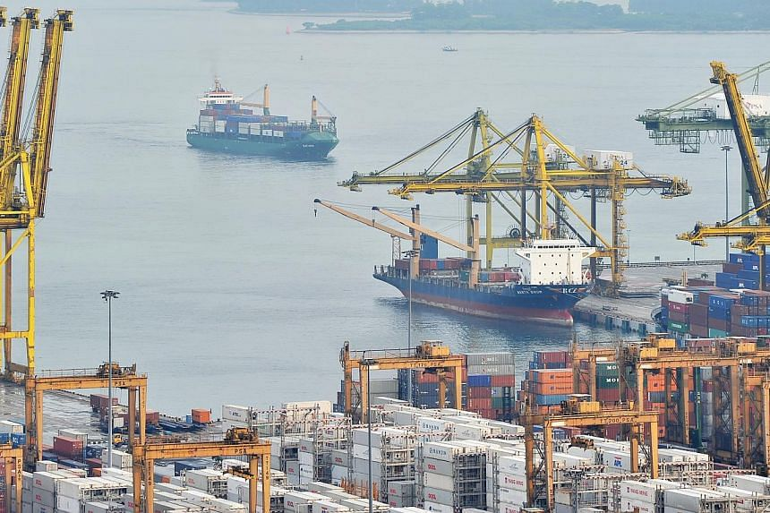 Singapore's non-oil domestic exports expanded 2.8 per cent in October after dipping 1.2 per cent the previous month, boosted by an increase in non-electronic shipments which outweighed a slide in electronic exports. -- ST FILE PHOTO: LIM YAOHUI