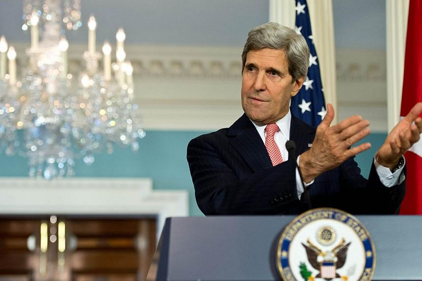US Secretary of State John Kerry speaks to the press with Turkish Foreign Minister Ahmet Davutoglu, at the State Department in Washington,DC on Nov 18, 2013. US Secretary of State John Kerry on Monday sought to play down hopes that a deal on Ir