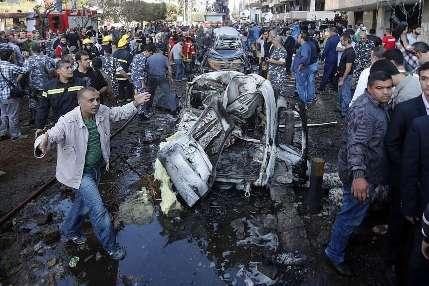 A man gestures at the site of a blast in Bir Hassan neighbourhood in southern Beirut, on Nov 19, 2013. Tehran accused Israel of carrying out deadly double blasts on Tuesday, Nov 19, 2013, outside the Islamic republic's embassy in Beirut that killed t