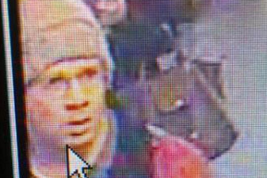 Taken from the footage of a security camera and released by the Paris Prefecture de Police, on Tue, Nov 19 2013, shows the alleged gunman walking at the Concorde underground station in Paris, France. A massive manhunt was under way, on Tue , Nov 19 2