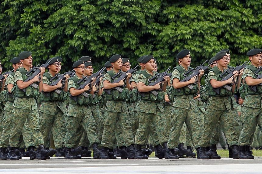 Members of Singapore Armed Forces pictured during the march pass at the SAF Day Parade held at SAFTI Military Institute on July 1, 2013. National service-bound males from polytechnics and institutes of technical education (ITEs) could take the Nation