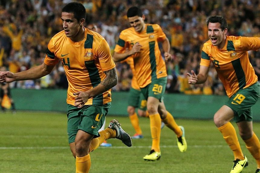 Australia's Tim Cahill (left) celebrates with team mates after scoring a goal during the international friendly soccer match against Costa Rica in Sydney. Cahill equalled Australia's national goalscoring record to give new coach Ange Postecoglou a wi
