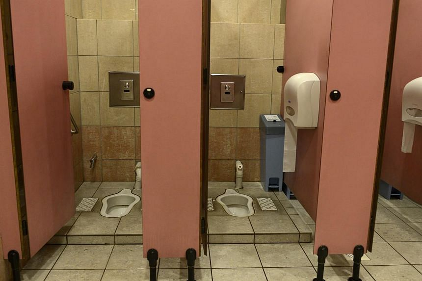 The female toilet in Ngee Ann City. Public toilets will be cleaner and more convenient following a slew of new guidelines announced by the National Environment Agency (NEA) on Tuesday, in line with World Toilet Day. -- ST FILE PHOTO: CAROLI