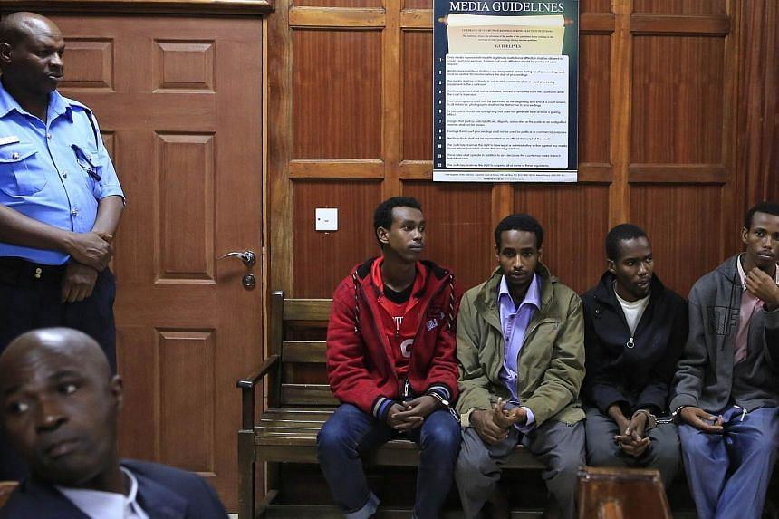 Somali men (from left) Mohamed Ahmed Abdi, Liban Abdullah Omar, Adan Mohamed Ibrahim and Hussein Hassan appear at the High Court for bail application in capital Nairobi, Nov 12, 2013. All four gunmen who attacked Kenya's Westgate mall trained in Soma