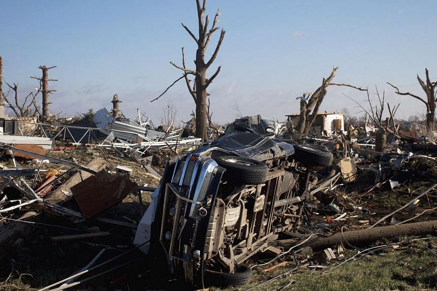 A truck lies on its side in a neighborhood in Washington, Illinois on Monday , Nov 18, 2013, after a tornado hit the area on Sunday damaging or destroying as many as 500 homes. One death was confirmed in the town as a result of the storm. Illinois wa