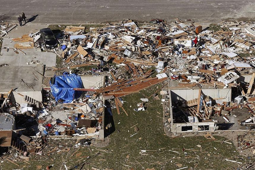 This aerial view on Monday, Nov 18, 2013, shows homes that were destroyed by a tornado that hit the western Illinois town of Washington on Sunday. It was one of the worst-hit areas after intense storms and tornadoes swept through Illinois. The Nation