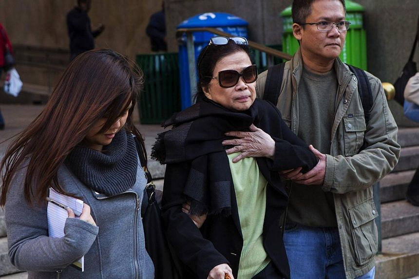 Vilma Bautista (centre), the ex-secretary of former Philippine first lady Imelda Marcos, leaves Manhattan Criminal Court in New York on Oct 21, 2013. Shewas convicted on Monday of conspiring to sell art that the former Philippine first lady acq