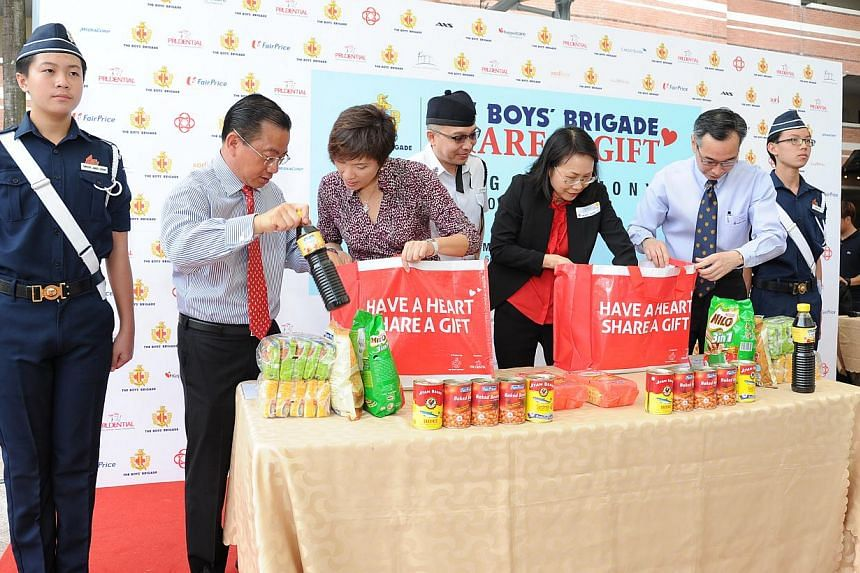 (From left) Mr Seah Kian Peng, CEO of NTUC FairPrice Singapore, Mrs Josephine Teo, Senior Minister of State for Finance and Transport and Member of Parliament for Bishan-Toa Payoh GRC, Mr Elliot Tan Vincent, Vice-President of The Boys' Brigade, Ms