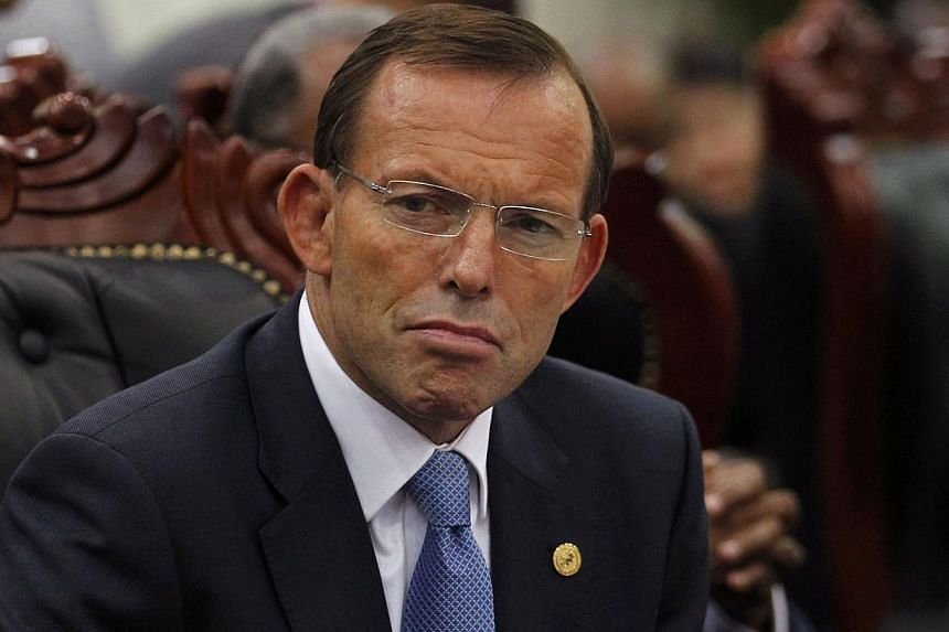 Australia's Prime Minister Tony Abbott attends a session of the Commonwealth Heads of Government Meeting (CHOGM) in Colombo, Nov 17, 2013. The question of whether Abbott should apologise to Indonesia over a spying row divided Australian media on Wedn