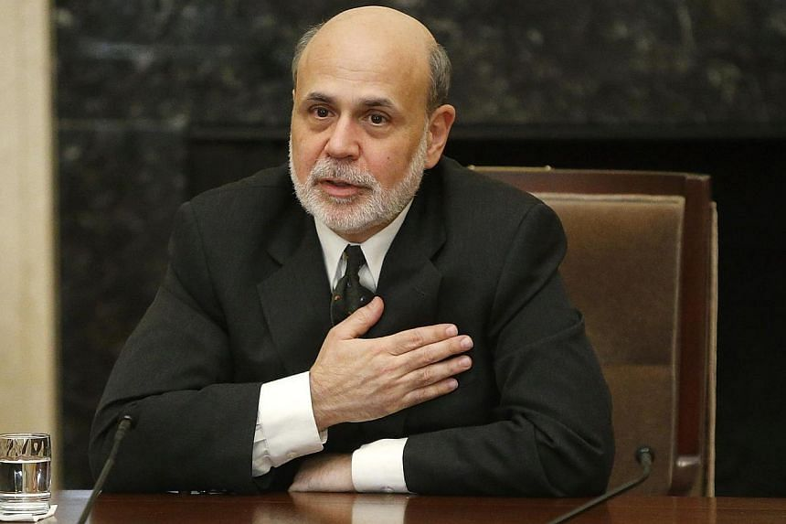 US Federal Reserve chairman Ben Bernanke thanks participants at the end of a town hall event with teachers at the Federal Reserve board's building in Washington on Nov 13, 2013. Mr Bernanke said on Nov 19 that the Fed will maintain ultra-easy United