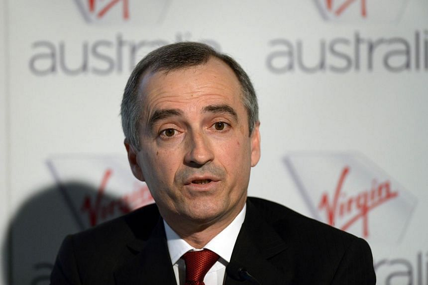 "Virgin Australia Airline chief executive officer John Borghetti announces company full year results in Sydney on Aug 30, 2013. Virgin Australia chief John Borghetti on Wednesday lashed out at ""offensive"" allegations made by Qantas in an escalating ro"