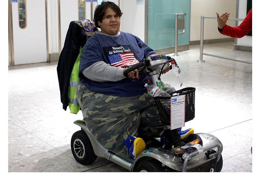 Frenchman Kevin Chenais, who was deemed too fat to fly, exits Heathrow Airport upon arrival on a plane from New York to London on Nov 19, 2013. Mr Chenais, who was stranded in the United States because he was deemed too heavy to fly, finally took a p