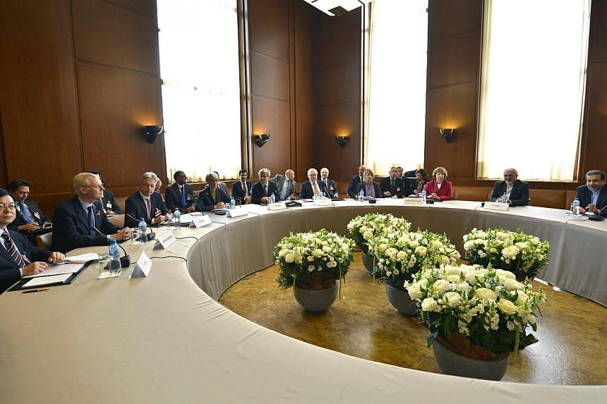 A general view shows participants before the start of two days of closed-door nuclear talks at the United Nations offices in Geneva Switzerland, on Thursday, Nov 7, 2013.Russia is hopeful that talks between Iran and world powers will produce a