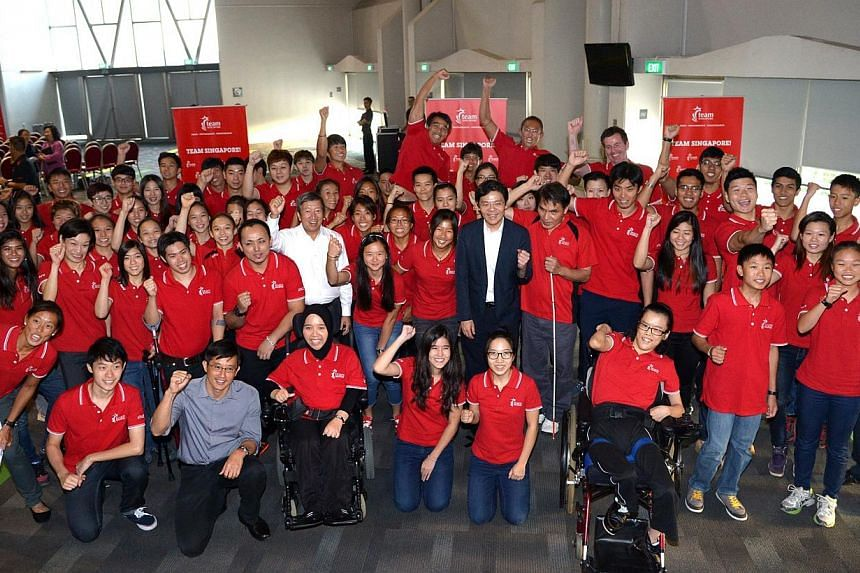 Acting Minister for Culture, Community and YouthLawrence Wong (standing in middle, in suit) with award recipients.Singapore's first batch of national athletes to be awarded the Sports Excellence (spex) scholarship were welcomed formally i