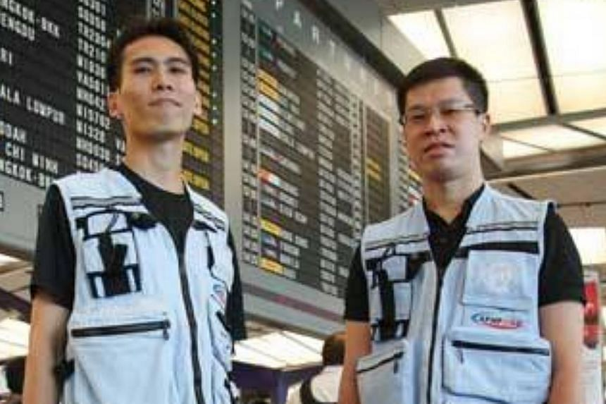 Staff Sergeant Jack Tan (left) and Captain Matthew Tay at Changi Airport. The Singapore Civil Defence Force has deployed a second team to the Philippines to assist with Typhoon Haiyan relief efforts. -- PHOTO: FROM SCDF FACEBOOK PAGE