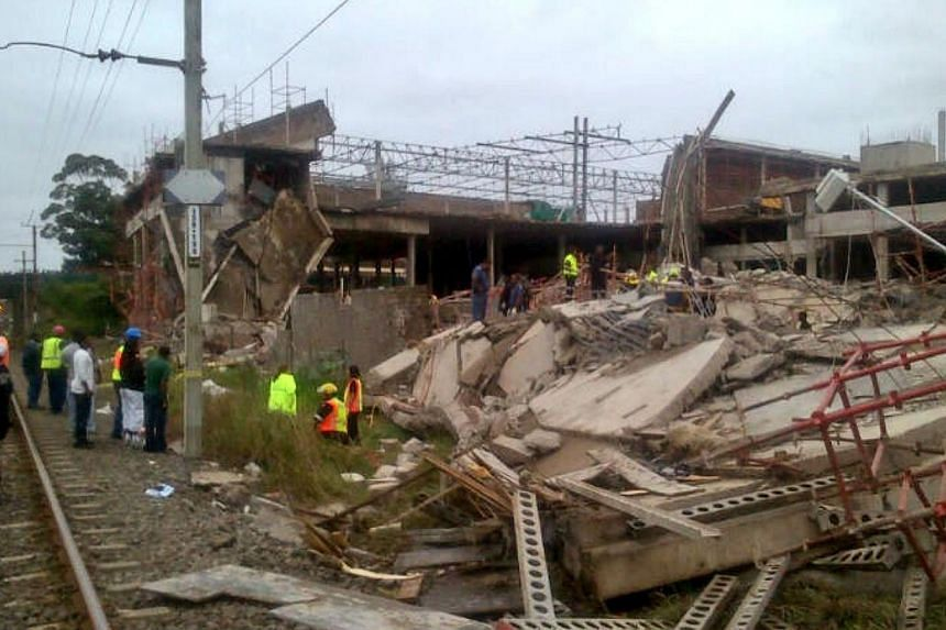 The scene of a mall that collapsed in Tongaat, South Africa, on Tuesday, Nov 19, 2013. Emergency workers said efforts to find survivors in the rubble of a collapsed half-built mall near the South African city of Durban were suspended on Wednesday, wi
