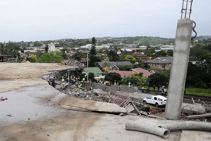 The scene of a mall that collapsed in Tongaat, South Africa, on Tuesday, Nov 19, 2013. -- PHOTO: AP