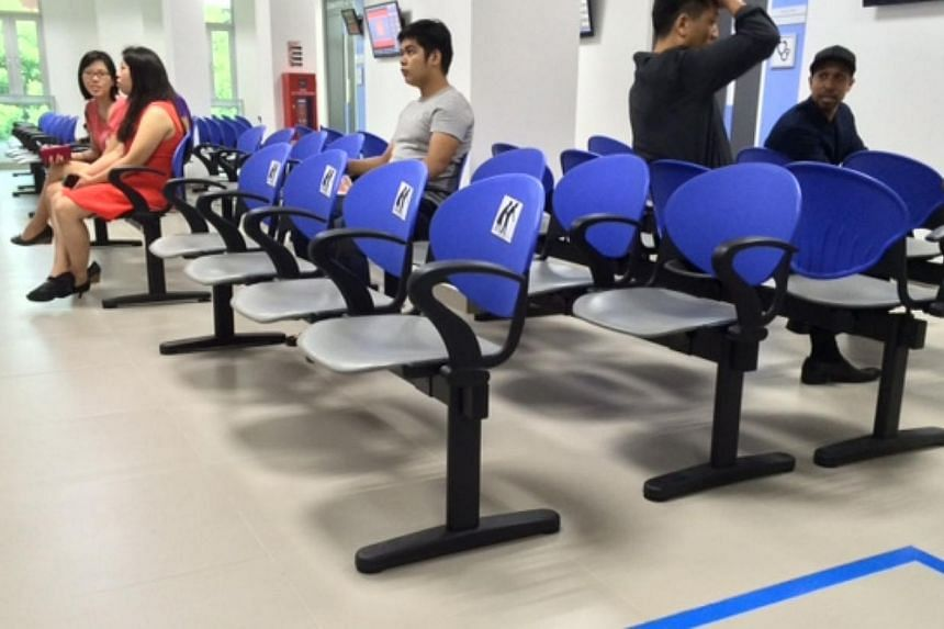 Armrests are provided on all seats, while the elderly have priority seating at Singhealth's Tampines Polyclinic, which re-opened for business on Wednesday after a five-month revamp.-- ST PHOTO: RACHEL TAN