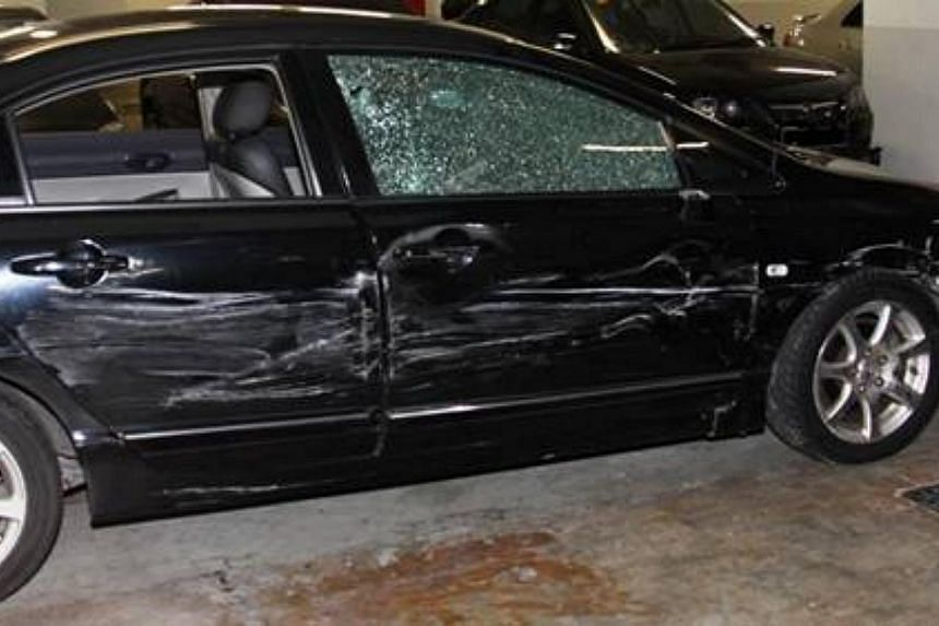 The damaged vehicle that the suspect used to evade arrest during CNB operation, on Nov 20, 2013. -- PHOTO: CENTRAL NARCOTICS BUREAU