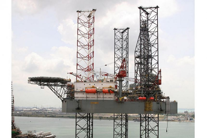 Keppel Fels, a subsidiary of Keppel Offshore & Marine, has clinched a contract worth US$265 million (S$329.6 million) to build a jack-up rig (pictured) for a unit of London-headquartered drilling company Ensco.-- ST FILE PHOTO: CAROLINE CHIA