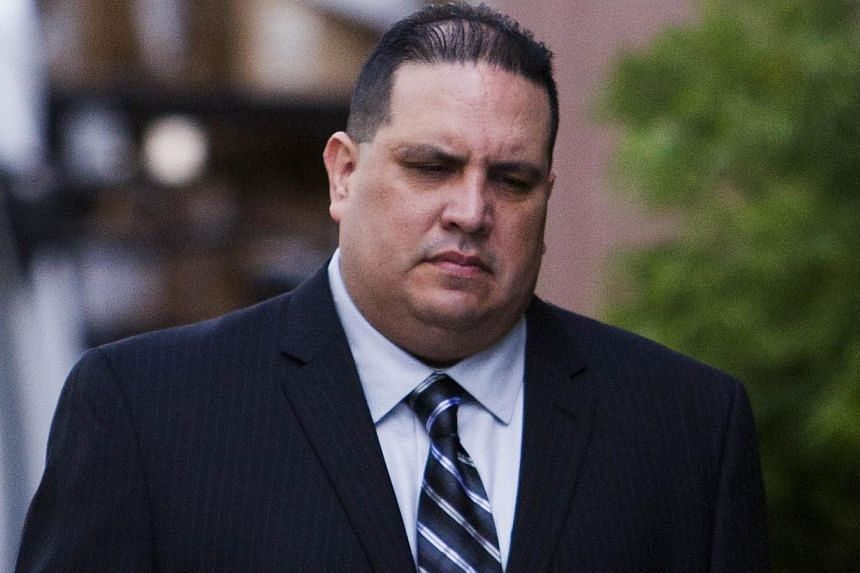 Navy Commander Jose Luis Sanchez arrives at the US District Court in San Diego, California, Nov 20, 2013. The commander appeared in court on Wednesday charged over a bribery scandal involving prostitutes, luxury travel and multimillion-dollar governm