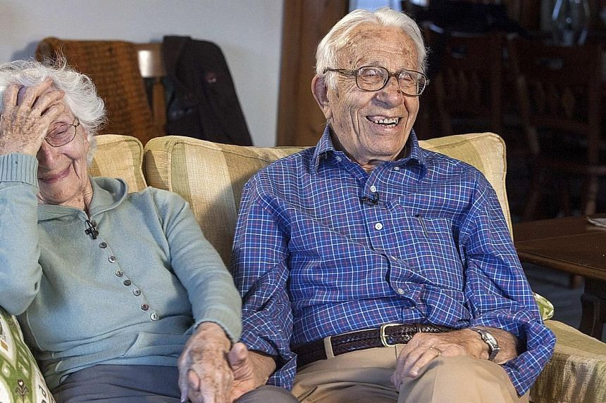 John Betar, 102, holds hands with his wife Ann, 98, at their home in Fairfield, Connecticut, on Nov 20, 2013. -- PHOTO: REUTERS