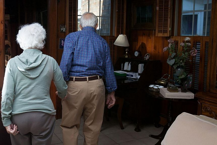 John Betar, 102, holds hands with his wife Ann (left), 98, as they walk at their home in Fairfield, Connecticut, on Nov 20, 2013. -- PHOTO: REUTERS