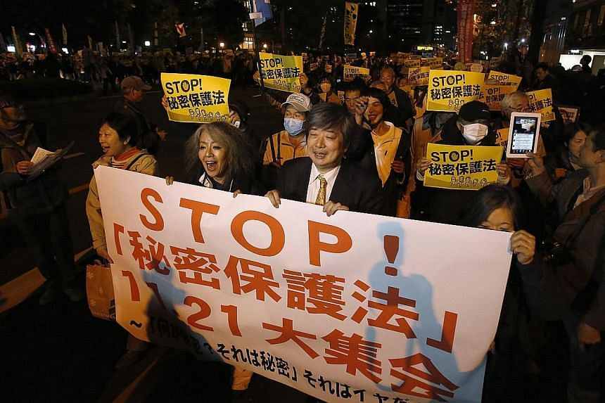 Protesters shout slogans during a march against the government's planned secrecy law, in Tokyo, on Nov 21, 2013. Thousands of people protested in Tokyo on Thursday against a proposed secrets act that critics say would stifle information on issues suc