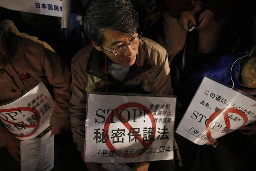 Protesters hold placards reading Stop Secrecy Act during a rally against the government's planned secrecy law in Tokyo, on Nov 21, 2013.-- PHOTO: REUTERS
