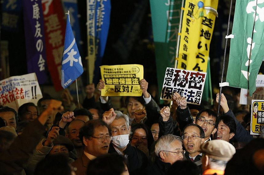 Protesters shout slogans during a march against the government's planned secrecy law, in Tokyo, on Nov 21, 2013. -- PHOTO: REUTERS