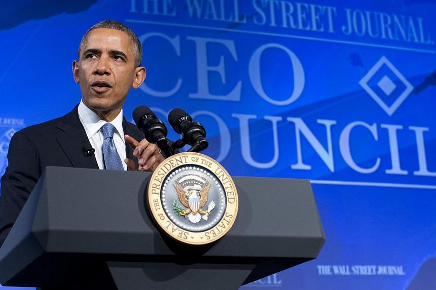 President Barack Obama gestures while speaking at the Wall Street Journal CEO Council annual meeting in Washington on Nov 19, 2013. Mr Obama will visit Asia in April after a government shutdown caused him to call off a trip last month, his national s