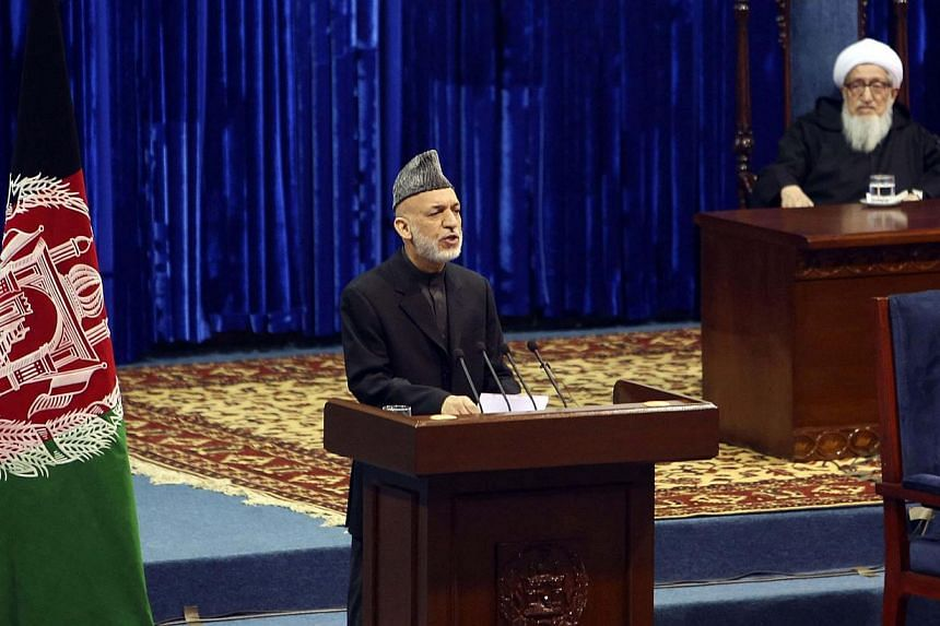 Afghan President Hamid Karzai speaks during the opening of the Loya Jirga, or grand council, in Kabul November 21, 2013.The White House objected to a plan by Afghanistan President Hamid Karzai that the security deal not go into effect until aft