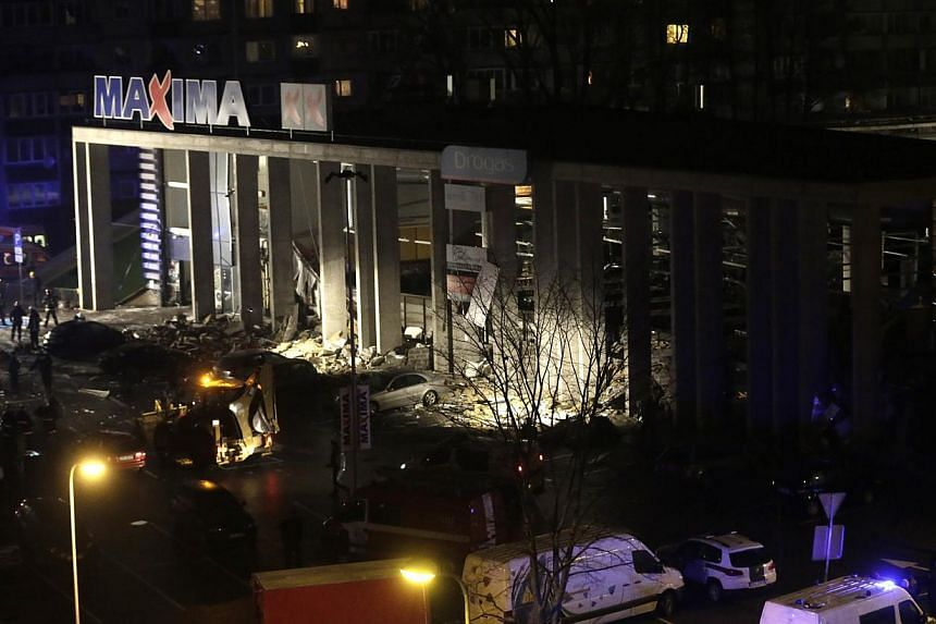 A store with a collapsed roof in Riga, Nov 21, 2013. Rescue services said on Friday that 12 people had died after the roof of a supermarket collapsed in the capital, Riga, the previous day. -- PHOTO: REUTERS