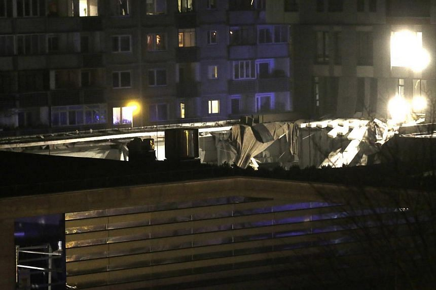The collapsed roof of a store is pictured in Riga, Nov 21, 2013. Rescue services said on Friday that 12 people had died after the roof of a supermarket collapsed in the capital, Riga, the previous day. -- PHOTO: REUTERS