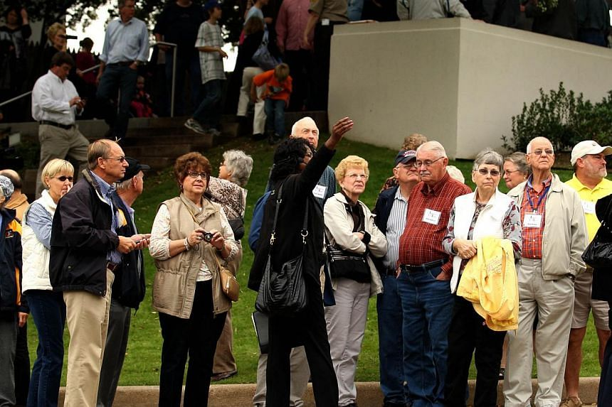 A group is given a tour at Dealey Plaza on Nov 21, 2013 in Dallas. The United States will on Nov 22, 2013, mark the 50th anniversary of the assassination of President John F. Kennedy, a dark turning point in the nation's history and a day many still