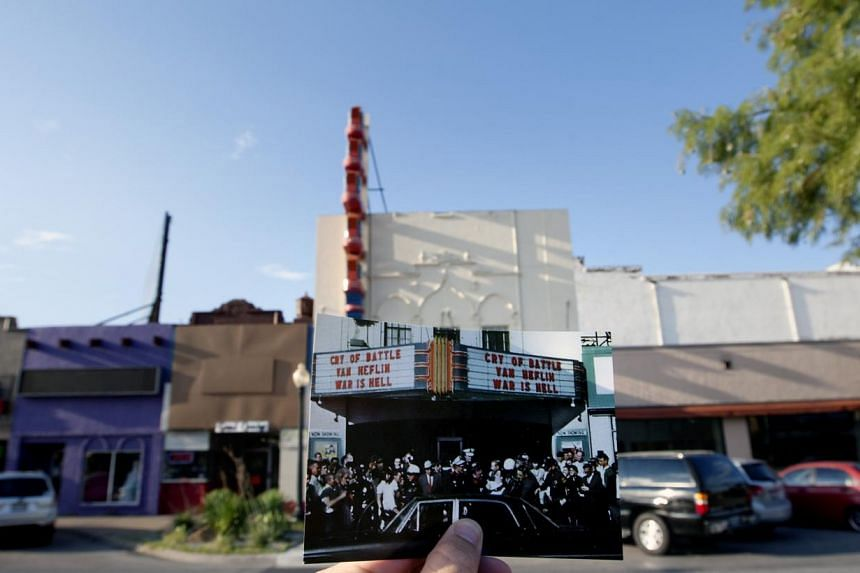This Sept 10, 2013 photo shows an image taken by Stuart Reed on Nov 22, 1963, of Lee Harvey Oswald's arrest, juxtaposed against the modern day Texas Theatre, in Dallas. The United States will on Nov 22, 2013, mark the 50th anniversary of the assassin