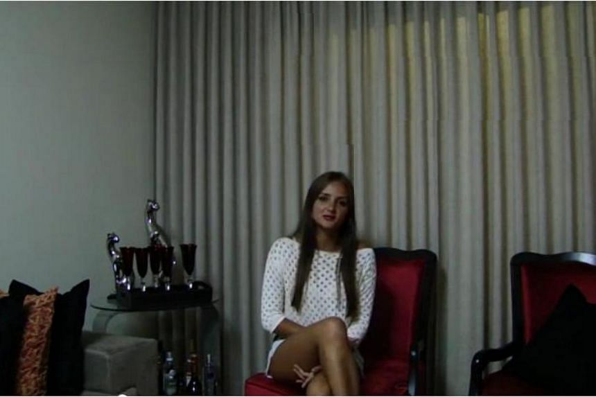 Ms Catarina Migliorini, a 21-year-old Brazilian woman who auctioned off her virginity online for $780,000 (S$970,000) last year, says she wants to sell it again as the deal was never consummated. -- PHOTO: SCREENGRAB FROM YOUTUBE