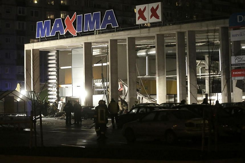 A general view shows a store with a collapsed roof in Riga on Nov 21, 2013. Four people were killed and around 30 others were injured in the incident. -- PHOTO: REUTERS