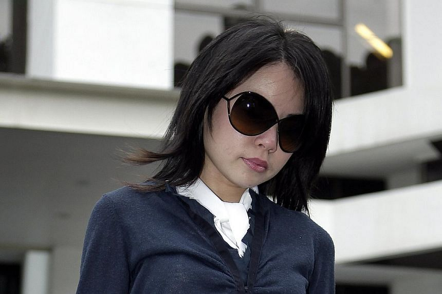 Goh Lee Yin, who has been given many chances after being caught shoplifting, failed in her appeal to escape jail for cheating - but she did managed to get her nine-month jail term halved for her latest offence, on Friday, Nov 22, 2013.-- ST FIL