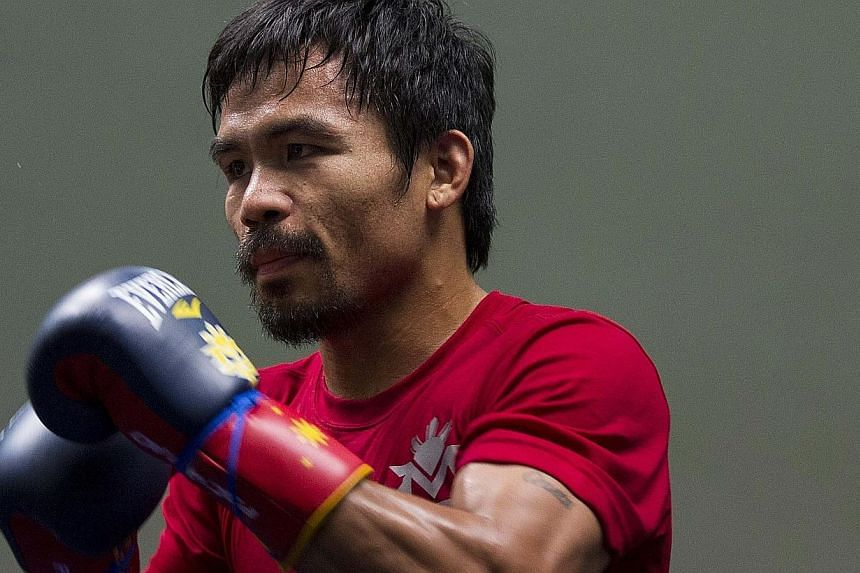 Filipino boxer Manny Pacquiao attends a training session at the Venetian Macao hotel in Macau, on Nov 21, 2013. Pacquiao is hoping to reclaim his chair at the top table in Macau on Sunday morning, when he faces American slugger Brandon Rios at the Co