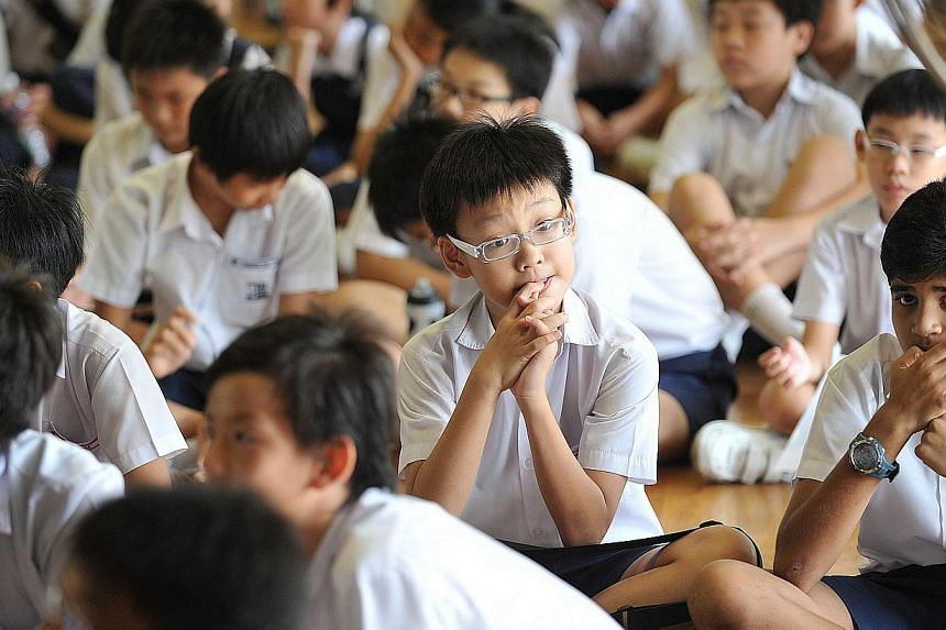 A nervous, nail-biting student from Rosyth School seen before the release of the PSLE results, on Nov 25, 2010.More pupils who sat the Primary School Leaving Examination (PSLE) this year made it to the Express stream in secondary school compare