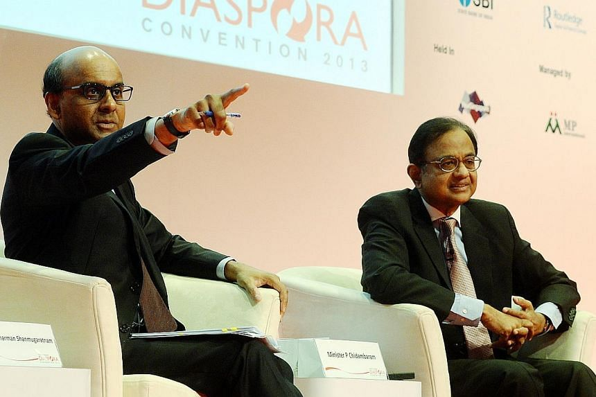 Mr Tharman Shanmugaratnam (left), Deputy Prime Minister and Minister for Finance, pointing to the audience during the question-and-answer session on Nov 21, 2013. With him is Mr P. Chidambaram, India's Minister of Finance. Like China and South-east A