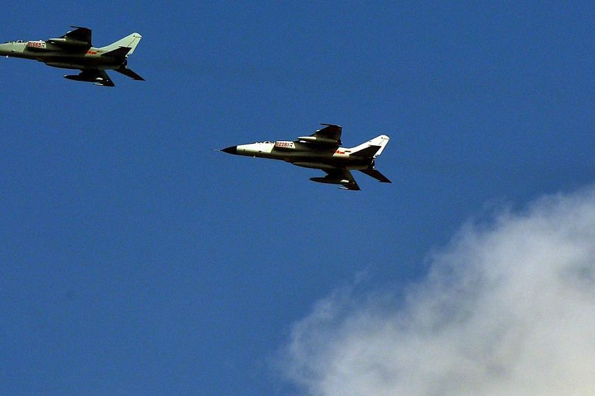 Chinese People's Liberation Army (PLA) fighter jets leaving their base in Shanghai. -- PHOTO: AFP