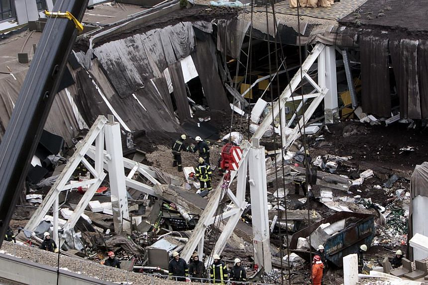 A view of collapsed Maxima supermarket in Riga, Latvia, Friday, Nov 22, 2013. Latvia's President demanded, on Saturday, Nov 23, 2013, that a supermarket cave-in which killed at least 53 people be treated as murder, while rescuers and investigators co