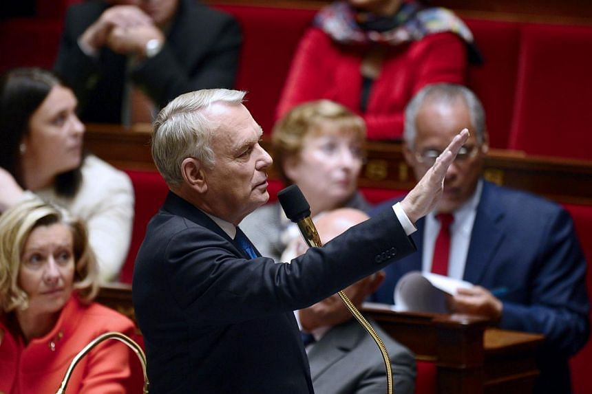 French Prime minister Jean-Marc Ayrault addresses members of Parliament during a session of questions to the government on Nov 19, 2013 at the National Assembly in Paris. After a path-breaking wine auction by the French presidential palace of so